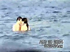 Sassy couple voyeured in the water seems to be fucking