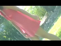 Girl in pink dress exciting park pussy up skirt