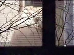 Voyeuring naked mature female through her opened window