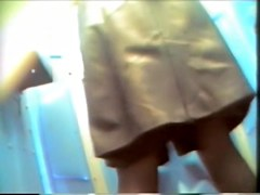 Stockings amateur lifting up skirt for spy cam pissing