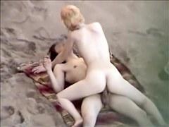 Blonde cutie riding her boyfriends dick on the beach