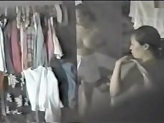 Sexy oriental girl spied as choosing what to wear