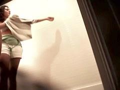 Leggy girls trying on summer dresses in fitting room