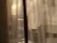 Female in bath robe was voyeured thru the window