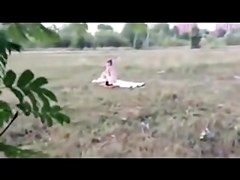 Man flashing his dick to the chick getting suntanned naked