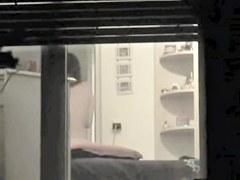 I am voyeuring neighbor in panty in the window