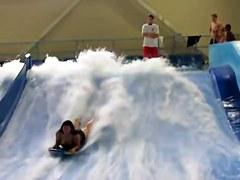 Sexy flowrider bikini downblouse in the aquapark