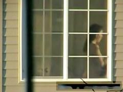 My neighbors nudity is getting voyeured in the window