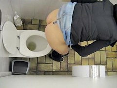 Girl in jeans skirt and tiny thong on toilet spy camera