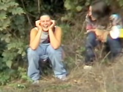 Real girls sat pissing outdoor and got voyeured on cam