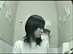 Japanese girl in jeans pissed over the toilet bowl