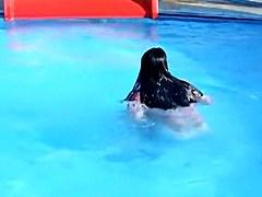 Sweet brunette doll has lost her bikini panty in the pool