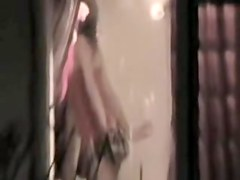 Sexy neighbor performing hot strip dance on voyeur cam