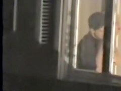 Man kissing the naked lover on window voyeur movie