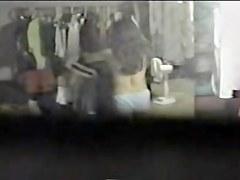 Sexy brunette in panty voyeured thru changing room window