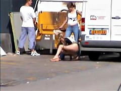 Kinky babe pissing in the public and voyeured on cam