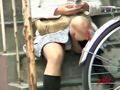 Pretty Asian babe made a voyeur skirt sharking her hot body