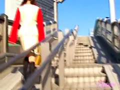 Hot girl with a yellow bag skirt sharked on the stairs