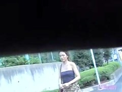 Sexy Asian with a thong got her skirt sharked while walking