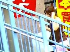 Happy Asian hottie got skirt sharked on a pedestrian bridge