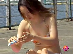 She was teasing the bikini sharks with the tanning oil