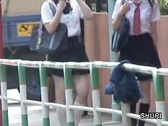 Asian teens have their panties down during street sharking.