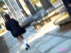 Asian babe gets embarrassing skirt sharking in a public park.
