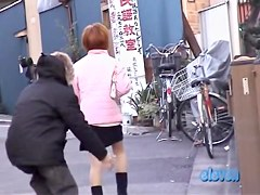 Man approaches cute girl and sharks her skirt up