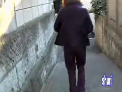 Asian babe gets her pants pulled by a street sharker.
