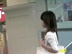 Amateur boob sharking in an underground shopping center