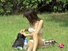 Japanese girl bikini sharked and left naked on the ground