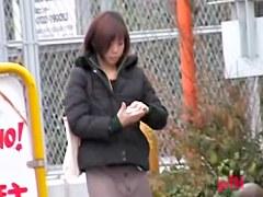 Japanese sharking video showing a cute gal in blue panties
