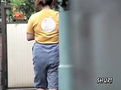 Street sharking with woman in jeans shorts