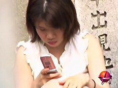 Sharking Japanese girl gets her small tits seen