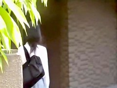 Sharking of a sexy Japanese chick in a white shirt