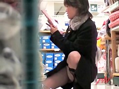 Asian girl unconscious upskirt tease in the market