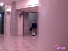 Hot Asian girl gets skirt sharked up in empty corridor