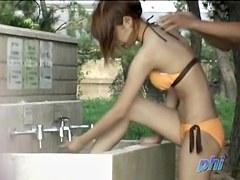 Sweet girl in bikini Asian scandal in the park