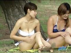 Two Japanese chicks in a kinky bikini sharking video