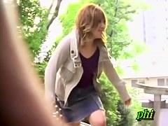 Girl smiles getting her jeans skirt sharked up