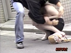 Man pulls the dress of japan beauty down