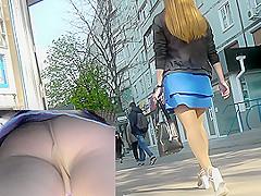 Upskirt voyeur video shows plump female in A-line skirt