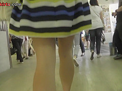 Real upskirt view of a raven-haired young girl in thong