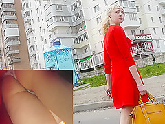 Blonde babe shows her panties in upskirt voyeur video
