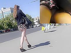 Skinny brunette participates in upskirt porno