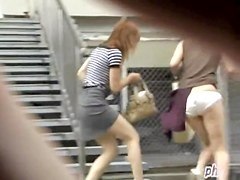 Two oriental doll loose their skirts when some chap snatches them away