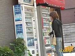Vending machine Shuri sharking scene of beautiful Asian brunette