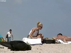 Sexy blondie relaxing on the nudist beach while I.m spying with my cam