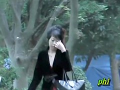Slim Japanese sweetie flashes her naked butt when someone snatches her skirt