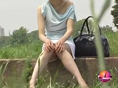 Playful elegant Japanese girl getting tricked during nature sharking